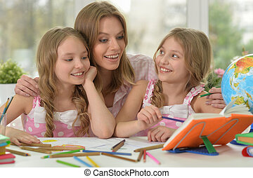 girls with mother on lesson of art - portrait of Cute girls...