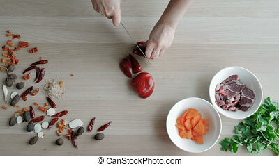 Female Hands Cutting Pepper, Making Salad. Top View Chief...