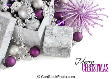Silver and purple Christmas ornaments border on white...