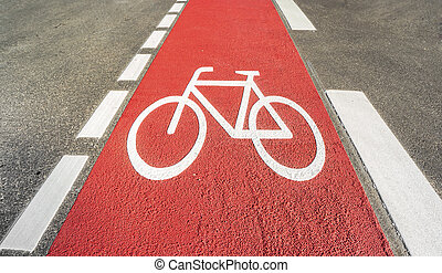 Red bicycle path with a bicycle symbol