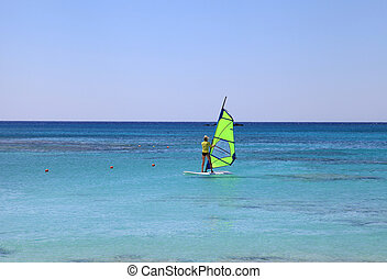 Windsurfer in Crete island, Greece - Back view of young...