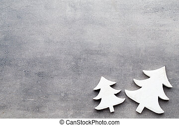 Christmas background. White tree decorations on a gray...
