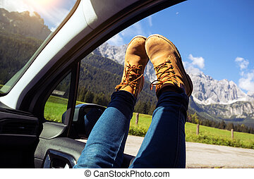 Girl legs sticking out of the car