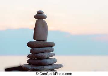 Stack of pebbles - Balancing some of stones on the seashore
