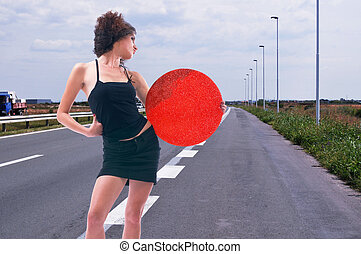 Hitch hike - Young woman hitch hiking on highway