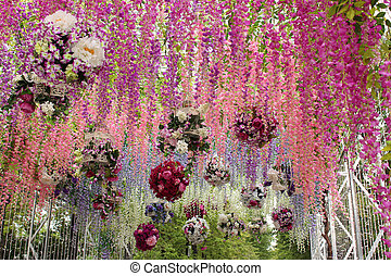 Arches made of artificial flowers - Fragment of arches made...