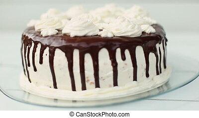 white cake covered with chocolate and cream - white cake...