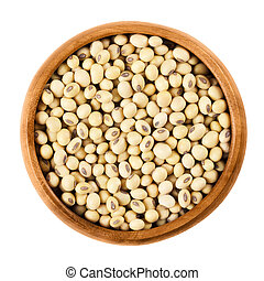 Soybeans in wooden bowl on white background. Glycine max,...
