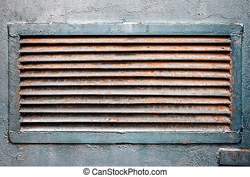 Rusty ventilation grille in metal wall - Rusty old...