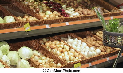 Couple roll trolley with products at the hypermarket - Young...