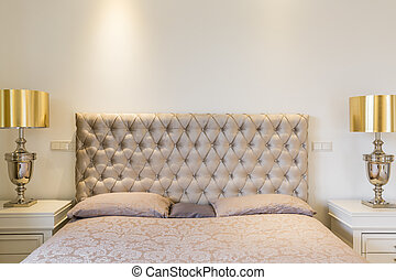 Quilted headboard bed - Close-up of double bed with quilted...