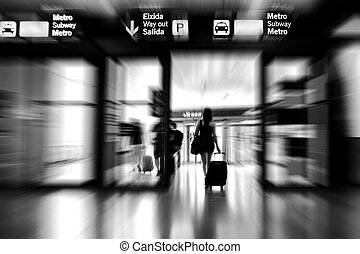 Airport Exit - Woman leaving the airport