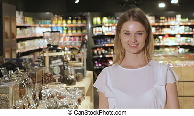 Girl shows her thumb up at the supermarket - Pretty...
