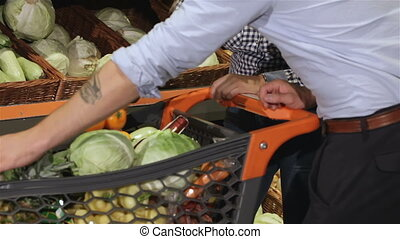 Couple choose squashes at the supermarket - Caucasian couple...
