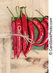 Fresh red hot chilli on wood background.