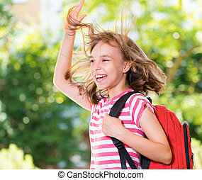 Girl back to school - Smiling girl 10-11 year old stretching...