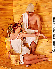 Couple in love wearing hat at sauna have relax. - Couple in...