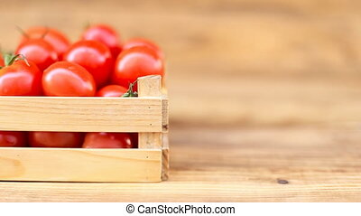 tomatoes with a small box - small box with tomatoes on...
