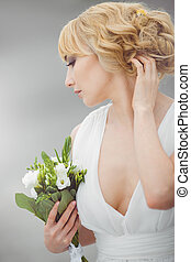 Young beautiful bride with a wedding bouquet - Portrait of a...