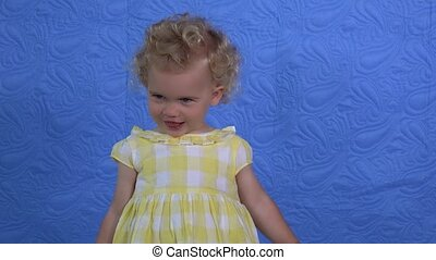 Cute girl showing various true emotions to camera. Child posing