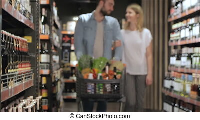 Couple shopping at the supermarket - Attractive caucasian...