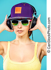 headphones - Modern young woman enjoys listening to music in...