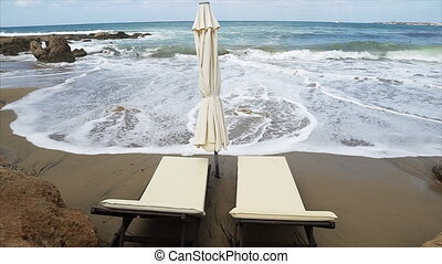 Sun beds by the sea. A peaceful holiday - Sun beds by the...