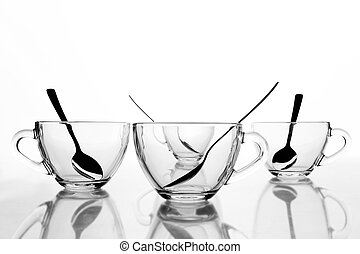 4 tea cups - 4 glass tea cups with reflection on white at...