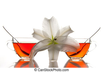2 tea cups and flower