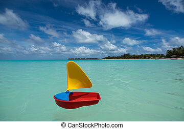 toy ship on the sea background