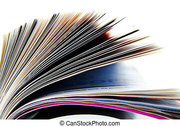 Closeup of a magazine\'s pages, on white