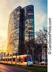 Tram in the center of Dusseldorf at sunset - Modern...