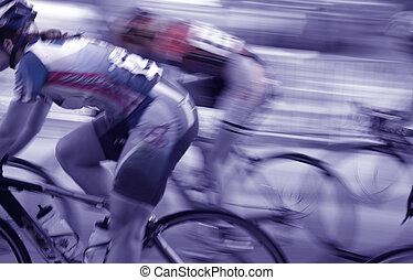 group of blurred women bike racers