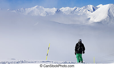 Panoramic view on snowboarder on snowy slope with new fallen...