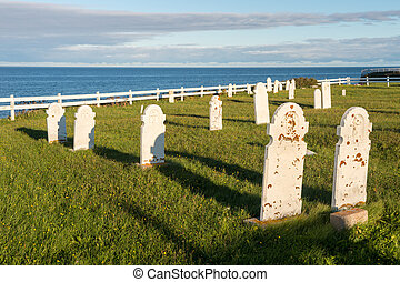 Cemetery with the ocean in the background, at sunset.