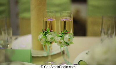 two glasses of champagne at the wedding table.