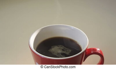 Cup with hot black coffee over white background.