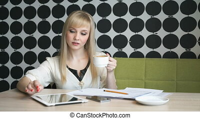 Lady sitting at the cafe during coffee break - Business lady...