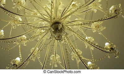 chandelier of glass or crystal hanging inside the hall...