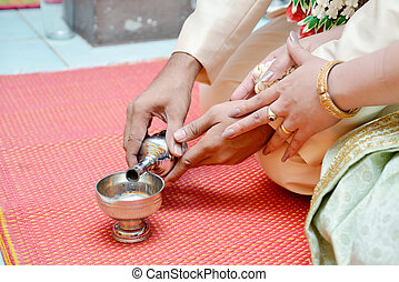 Buddhist's grail pouring water