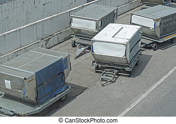 Unit load devices containers at dolly carts at airport