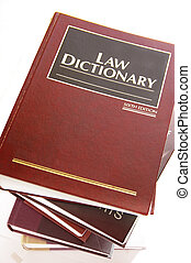 law dictionary books stacked, on white