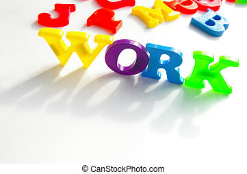 "Children\'s colorful plastic letters spelling ""work\"""