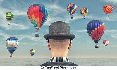 Man looks at hot air balloons