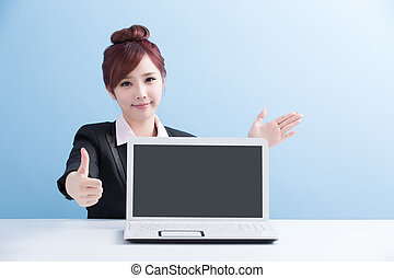 business woman show computer to you with isolated on blue...