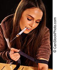 Female drug addict with syringe. Choice she has made. -...