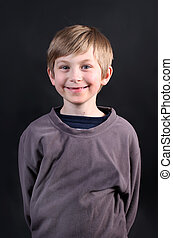 Cute young eight year old boy - Smiling cute eight year old...