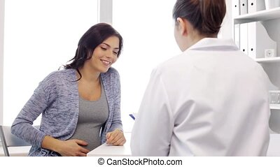 gynecologist and pregnant woman at hospital - pregnancy,...