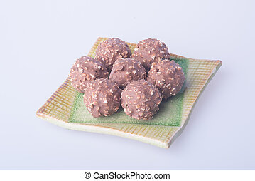 chocolate ball or chocolate bonbon on a background. -...