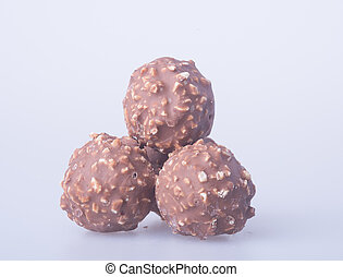 chocolate ball or chocolate bonbon on a background -...